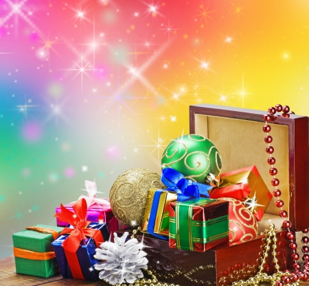 Christmas decorations, balloons and gifts in a wooden box on a background with space for text photo