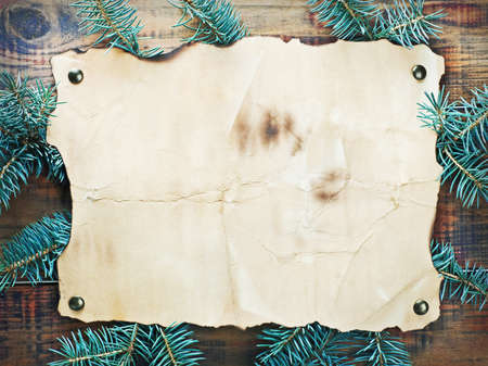 Christmas decorations, paper and spruce branches on a wooden wall photo
