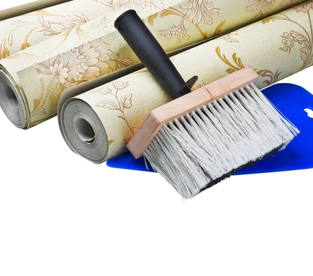 redecorate: wallpaper and brush sticking isolated on white background
