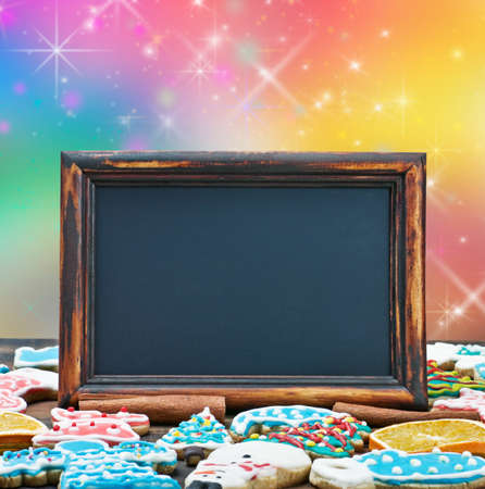 blackboard with space for text on the background and the color of Christmas gingerbread photo