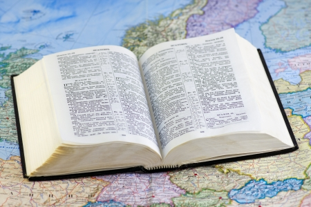 open Bible rests on the world map