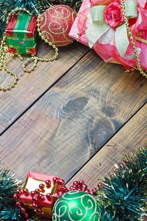 Christmas decorations and gifts on wooden background texture photo