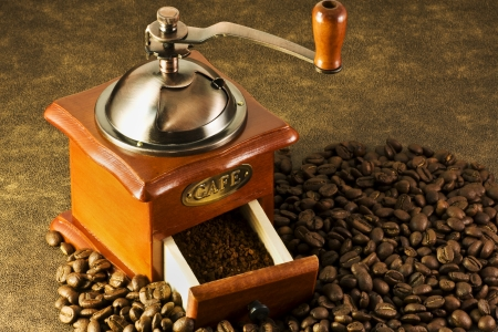 is on the coffee grinders and coffee beans brown background  photo