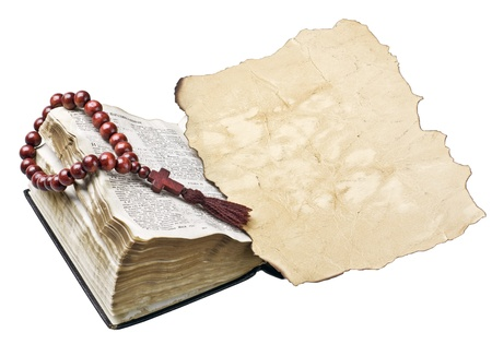 bible with rosary and old burnt piece of paper  photo