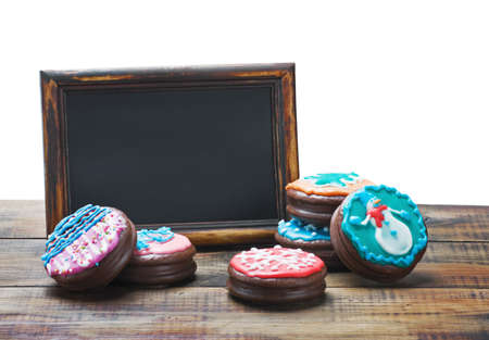 blackboard and chocolate cakes with icing for text isolated on white background Stock Photo - 16768042