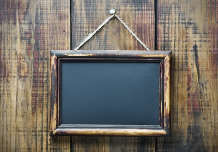 Blackboard on wooden background with space for text  photo