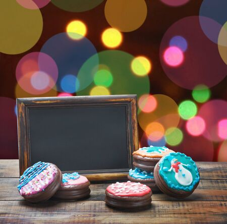 blackboard and chocolate cakes with icing for text photo