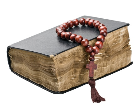 piety: Bible and rosary isolated on white background  Stock Photo
