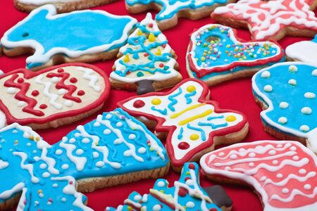 Christmas gingerbread cookies on the table covered with a red cloth  Stock Photo - 16839746