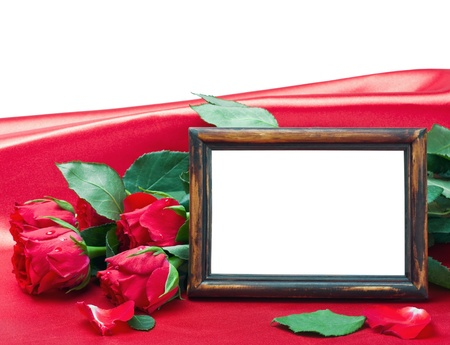 Valentine's day roses and photo frame with space for text on a red background photo