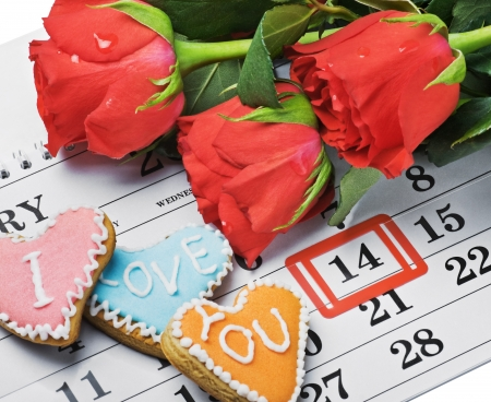 number 14: red roses lay on the calendar with the date of February 14 Valentines day