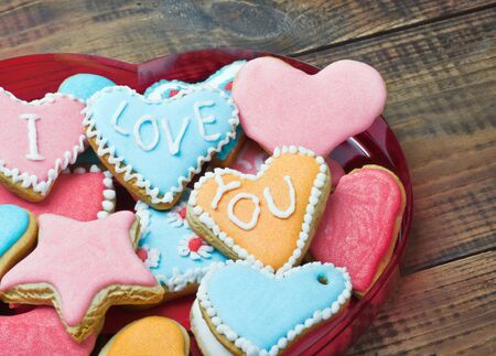 sweet love: Valentine cookies with the words I love you on the table