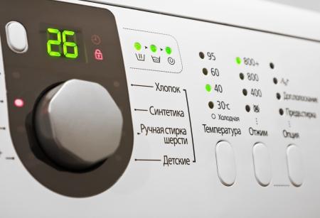 control panel lights: Closeup of a control panel of white washing machine Stock Photo