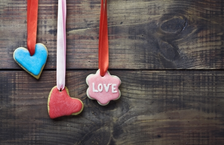 frosting: Valentine cookies decorated with frosting and confectionery sugar Stock Photo