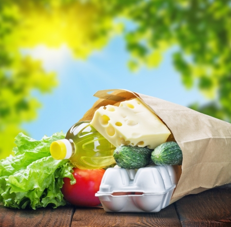 fresh food in a paper bag on a background of nature photo