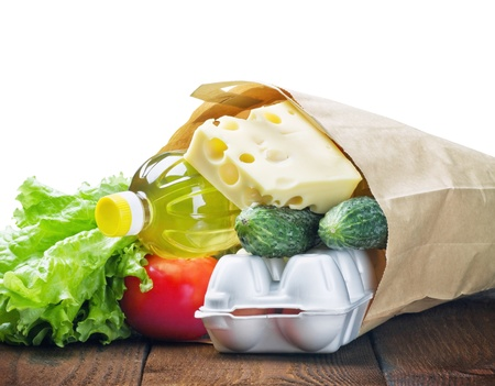 fresh food in a paper bag isolated on white background Stock Photo - 17705136