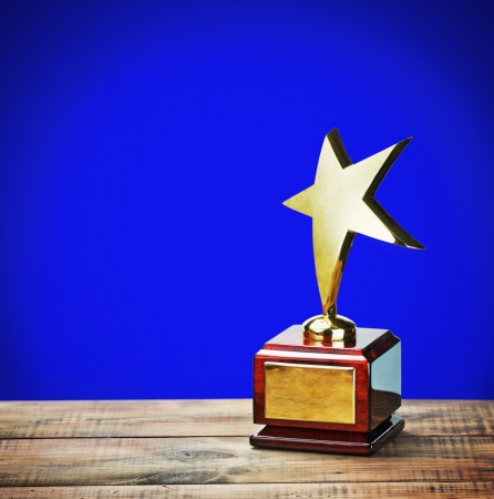 star award with space for text on a blue background Stock Photo