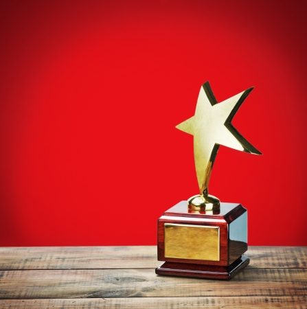 background trophy: star award with space for text on a red background