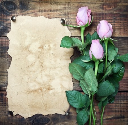 Flowers on vintage wood background with blank