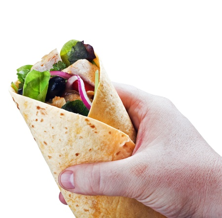 tortilla with meat in hand isolated on white background Archivio Fotografico