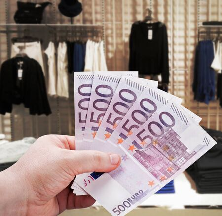 man's hand holding a euro to new shopping in the supermarket Stock Photo - 18436757
