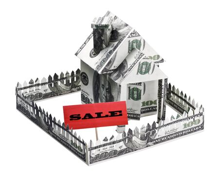 house made of money with a sign for sale isolated on white background Stock Photo - 18588005