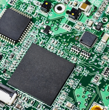 Microchips and condensers assembly on the circuit board  Stock Photo