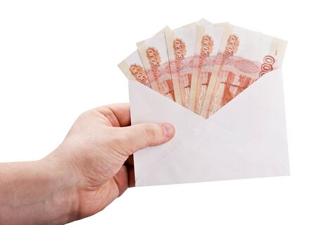 hand holding an envelope with rubles isolated on white background Stock Photo - 19143708