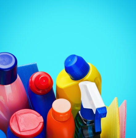Cleaning supplies on blue background Stock Photo - 19259872
