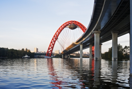 View of the river and the modern cable-stayed bridge in Moscow on a summer morning photo