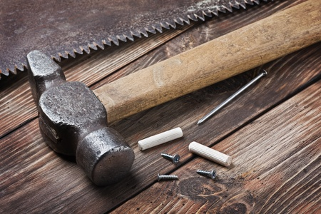 old tools for repairing lie on a wooden table photo