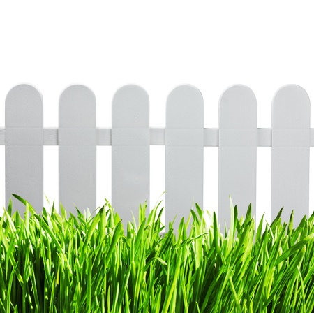 white garden fence and green grass isolated on white background photo