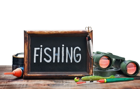 fishing gear and blackboard isolated on white background photo