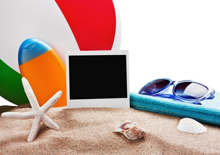 photoframe, towel and sunglasses and other accessories for the beach photo