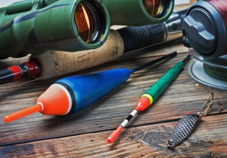 fishing tackle on a wooden table. Focus on the float photo