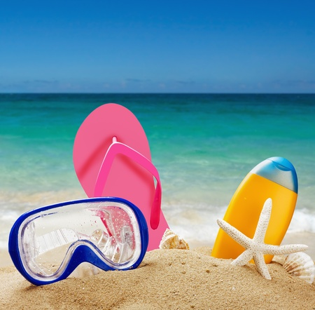 beach accessories in the sand against the sea landscape photo