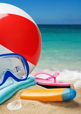 beach accessories on a background of sea and sand photo
