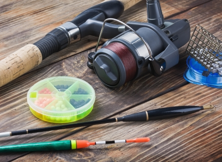 bass fishing: fishing tackle on a wooden table