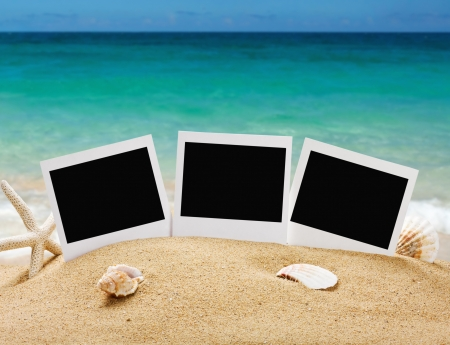 photo frames on the sea sand on the beach background photo