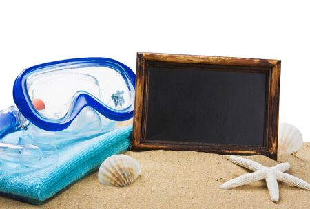 blackboard on the sand and other things for the beach isolated on white background photo