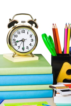 alarm clocks and school supplies isolated on white background photo