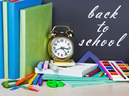 inscription on the chalkboard back to school and supplies for school photo