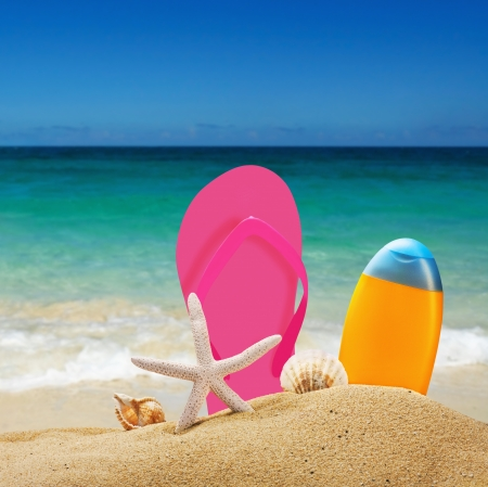 beach accessories for relaxing in the sand against the sea landscape photo