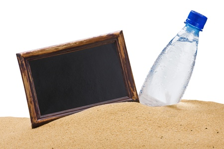 bottle of water and a black board for the text on the sand photo