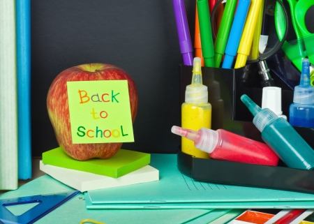 paper sticker with text back to school pasted on the apple photo