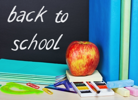 school supplies and a blackboard with text back to school photo