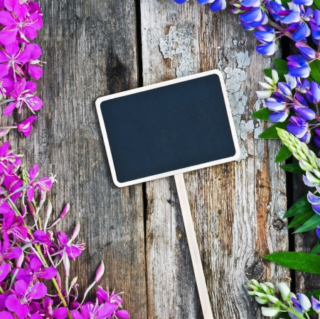 wild flowers and a black board with space for text photo