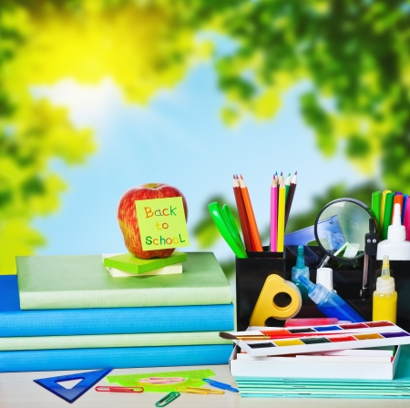 school table: school supplies on the background of autumn leaves