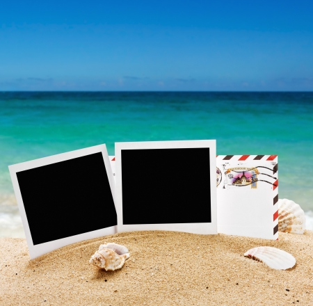 empty photo frame and a letter from vacation in the sand Stock Photo - 21529818
