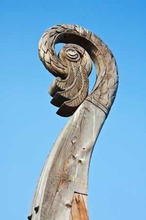 ship wreck: carved birds head on a boat Viking Drakkar in Vyborg. Russia